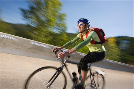 Woman Riding Bicycle, Steamboat Springs, Routt County, Colorado, USA Stock Photo - Premium Royalty-Free, Code: 600-03210486
