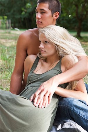 Couple Relaxing Outdoors Stock Photo - Premium Royalty-Free, Code: 600-03210534