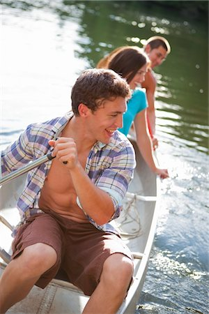 Teenagers Canoeing on Lake Near Portland, Oregon, USA Stock Photo - Premium Royalty-Free, Code: 600-03210548