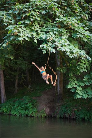Teenage Girl Jumping Into Lake, Near Portland, Oregon, USA Stock Photo - Premium Royalty-Free, Code: 600-03210556