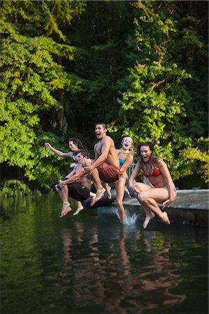 recreation - Group of Friends Jumping Into Lake, Near Portland, Oregon, USA Stock Photo - Premium Royalty-Free, Code: 600-03210560