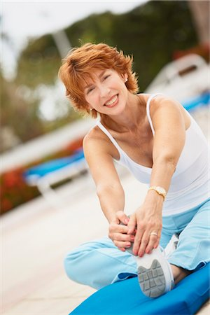 Woman Stretching Stock Photo - Premium Royalty-Free, Code: 600-03227498