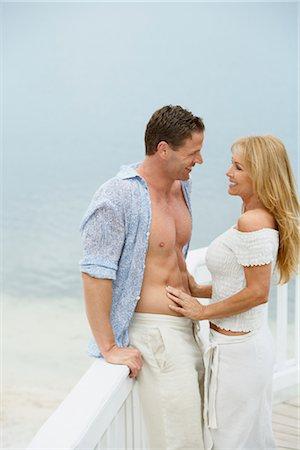 Couple on Dock, Mount Dora, Lake County, Greater Orlando, Florida, USA Stock Photo - Premium Royalty-Free, Code: 600-03230117