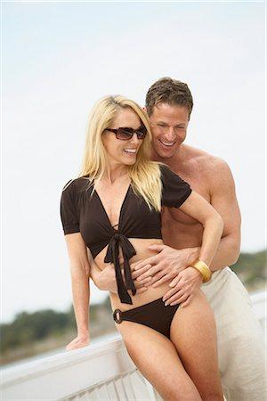 Couple on Dock, Mount Dora, Lake County, Greater Orlando, Florida, USA Stock Photo - Premium Royalty-Free, Code: 600-03230120