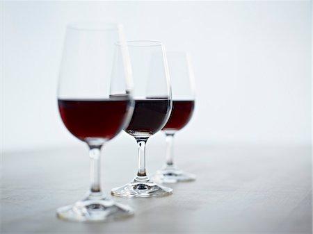 Still Life of Three Glasses of Red Wine Stock Photo - Premium Royalty-Free, Code: 600-03230259