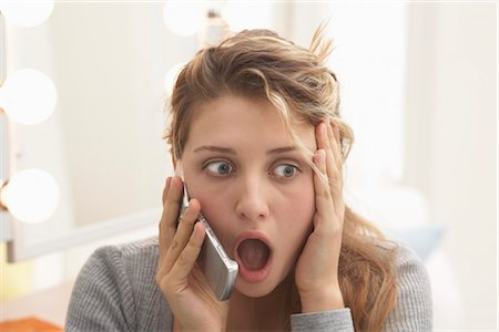 people in panic - Teenager Talking on Cellular Telephone Stock Photo - Premium Royalty-Free, Code: 600-03244227