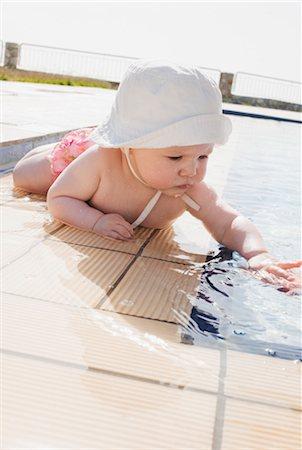 Baby Girl at Edge of Pool Stock Photo - Premium Royalty-Free, Code: 600-03284215