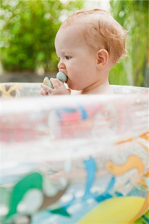 Baby Girl in Inflatable Pool Stock Photo - Premium Royalty-Free, Code: 600-03284221
