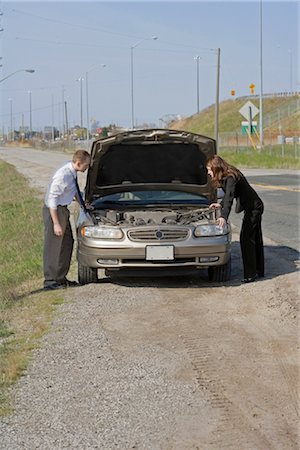 stalled car - Man and Woman With Car Trouble Looking Under the Hood Stock Photo - Premium Royalty-Free, Code: 600-03365737