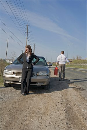 stalled car - Man With Car Trouble, Man Hitchhiking With Jerry Can Stock Photo - Premium Royalty-Free, Code: 600-03365739