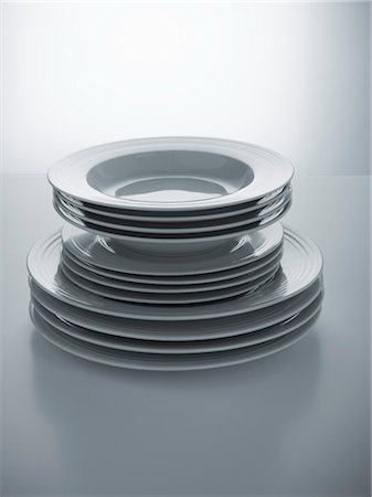 set - Stack of Matching Plates Stock Photo - Premium Royalty-Free, Code: 600-03368732