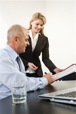 Businessman Signing Papers Stock Photo - Premium Royalty-Free, Code: 600-03404524