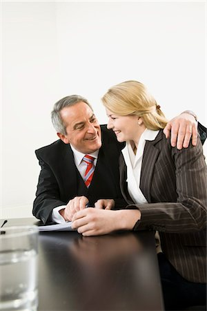 Businessman with Arm Around Businesswoman Stock Photo - Premium Royalty-Free, Code: 600-03404527