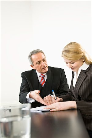 Businesswoman Signing Papers Stock Photo - Premium Royalty-Free, Code: 600-03404528