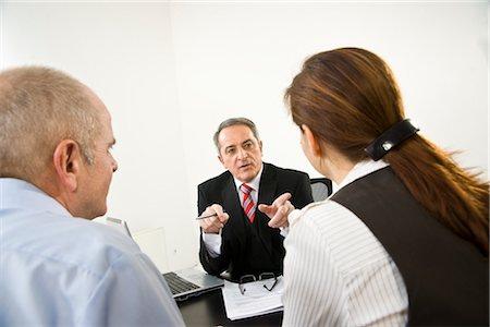 Businessman Talking to Employees Stock Photo - Premium Royalty-Free, Code: 600-03404529