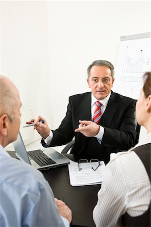 Businesspeople in Consultation Stock Photo - Premium Royalty-Free, Code: 600-03404531