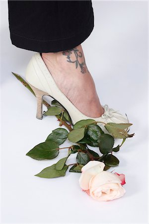 Woman With Tattoo Stepping on a Rose Stock Photo - Premium Royalty-Free, Code: 600-03404928