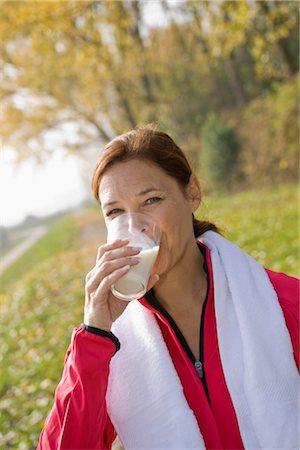 Portrait of Woman Drinking Milk Stock Photo - Premium Royalty-Free, Code: 600-03404923