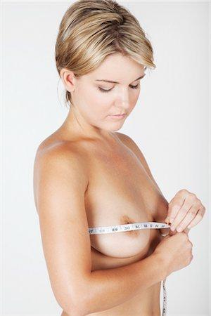 Woman Measuring Breasts Stock Photo - Premium Royalty-Free, Code: 600-03405618