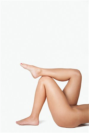 Nude Woman's Crossed Legs in Studio Stock Photo - Premium Royalty-Free, Code: 600-03405619
