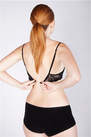 Woman Fastening Bra Stock Photo - Premium Royalty-Free, Code: 600-03405630