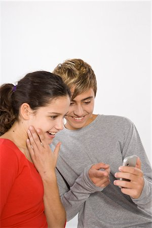 Teenage Girl and Boy with Cell Phone Stock Photo - Premium Royalty-Free, Code: 600-03403985