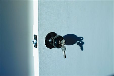 Keys in Door Lock Stock Photo - Premium Royalty-Free, Code: 600-03439328