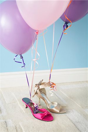 Balloons Tied to Shoes Stock Photo - Premium Royalty-Free, Code: 600-03445416