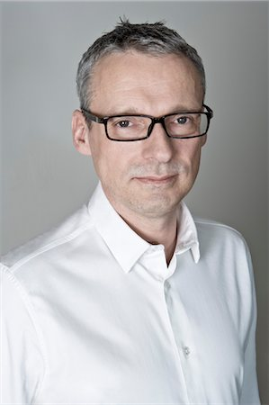Portrait of Man wearing White Shirt and Eyeglasses Stock Photo - Premium Royalty-Free, Code: 600-03445604