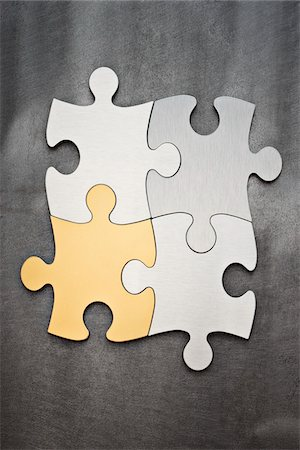 Close-up of Puzzle Pieces Stock Photo - Premium Royalty-Free, Code: 600-03448793