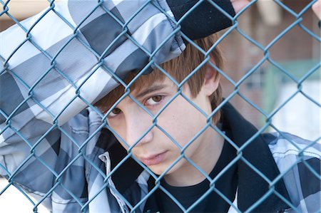 Boy Behind Fence Stock Photo - Premium Royalty-Free, Code: 600-03456209