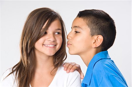 preteen girl boyfriends - Girl and Boy Kissing Stock Photo - Premium Royalty-Free, Code: 600-03456254