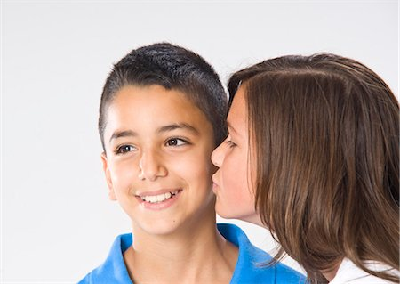 Girl and Boy Kissing Stock Photo - Premium Royalty-Free, Code: 600-03456256