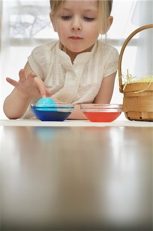 dyed - Little Girl Colouring Easter Eggs Stock Photo - Premium Royalty-Free, Code: 600-03456685
