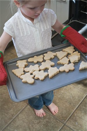 Little Girl Baking Christmas Cookies Stock Photo - Premium Royalty-Free, Code: 600-03456693