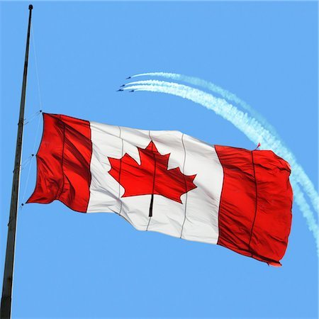 flag at half mast - Canadian Flag at Half Mast, Snowbirds in the Background Stock Photo - Premium Royalty-Free, Code: 600-03456712