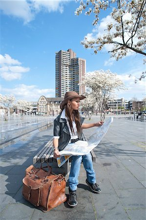 Woman Looking at Map, Mannheim, Baden-Wurttemberg, Germany Stock Photo - Premium Royalty-Free, Code: 600-03456846