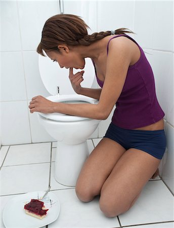 Woman Vomiting in Bathroom Stock Photo - Premium Royalty-Free, Code: 600-03456849