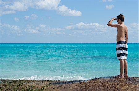 Boy Looking at Caribbean Sea, Playa del Carmen, Yucatan Peninsula, Mexico Stock Photo - Premium Royalty-Free, Code: 600-03456873