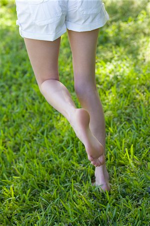 female 16 year old feet - Woman Walking in the Grass, Miami Beach, Dade County, Florida, USA Stock Photo - Premium Royalty-Free, Code: 600-03458174