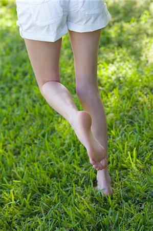 Woman Walking in the Grass, Miami Beach, Dade County, Florida, USA Stock Photo - Premium Royalty-Free, Code: 600-03458174