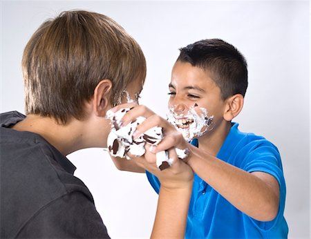 Boys Having a Food Fight Stock Photo - Premium Royalty-Free, Code: 600-03463158