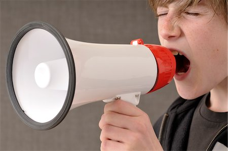 Boy Yelling through Megaphone Stock Photo - Premium Royalty-Free, Code: 600-03463192