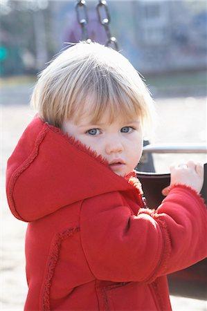 shy baby - Little Girl Playing at Sorauren Avenue Park, Toronto, Ontario, Canada Stock Photo - Premium Royalty-Free, Code: 600-03463209