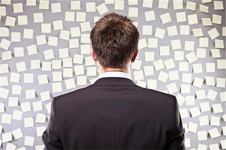 Businessman Looking at a Wall Full of Self Adhesive Notes Stock Photo - Premium Royalty-Free, Code: 600-03520294