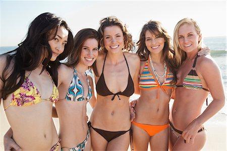 Portrait of Young Women Standing on Beach, Zuma Beach, California, USA Stock Photo - Premium Royalty-Free, Code: 600-03520505