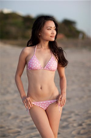 Portrait of Young Woman Standing on Beach, Zuma Beach, California, USA Stock Photo - Premium Royalty-Free, Code: 600-03520713