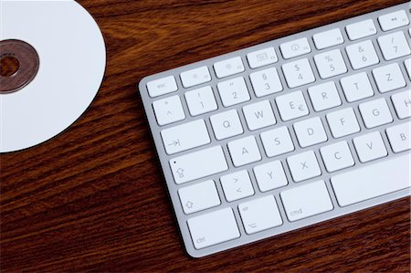 Computer Keyboard and DVD Stock Photo - Premium Royalty-Free, Code: 600-03537950