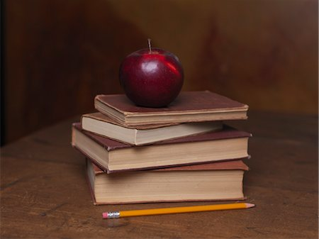 education concept - Stack of Old Books With Apple and Pencil Stock Photo - Premium Royalty-Free, Code: 600-03554408