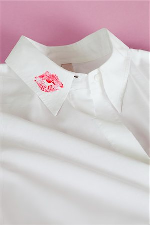 flirting - Lipstick Kiss on Shirt Collar Stock Photo - Premium Royalty-Free, Code: 600-03567825